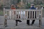 strangers on bench