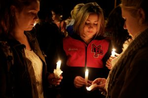 Students and community members attend a vigil at the Grove Church after a shooting at Marysville-Pilchuck High School in Marysville
