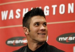 Baseball player Bryce Harper smiles during a news conference where the Washington Nationals introduced him as their first overall selection in the 2010 First-Year Player Draft, at Nationals Park in Washington Thursday, Aug. 26, 2010. Harper  agreed to a $9.9 million, five-year deal with the baseball club last week. (AP Photo/Alex Brandon)