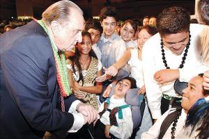 monson helping others